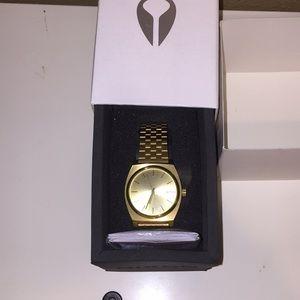 All gold Nixon watch